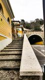 Cars have to go to the tunnel, and people climb up the stairs on royalty free stock images