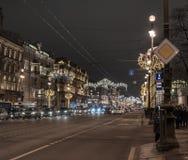 Night city Saint-Petersburg road illumination cars historical building. Road cars night city Saint-Petersburg lights illumination royalty free stock images