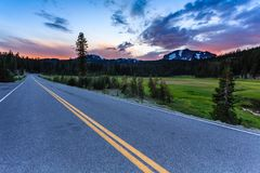 On the road in the cascade mountains looking at the  dramatic sunrise Stock Photo