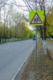 road with a caution sign children royalty free stock photo
