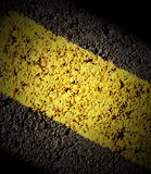 Road Cement Texture Background. A closeup of a road with a yellow line divider. There is shadow and lots of texture for a background. Use the photo for a car Stock Photo