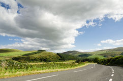 Road into Cheviot Hills. The rolling hills of Northumberland National Park Stock Photos