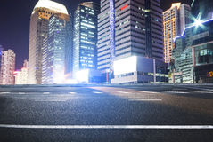 The road in the city. Asphalt road and modern city Stock Images