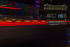 Road in the city at night with the light passing through it  the speed of cars on long exposure, selective focus Stock Photo