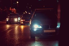 Night view of the cars. Road in the city at the night with yellow and red electrical light for cars during they are stock images