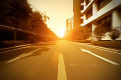 Road in city with sunset Stock Photography