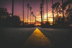 Road in City during Sunset Stock Images