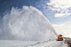 Road cleaning by snow removal machine. Royalty Free Stock Photography