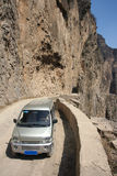 Road in cliff. A microbus stops at the road in cliff royalty free stock image