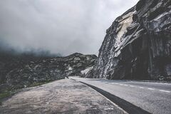 Road beside cliffs Royalty Free Stock Photo