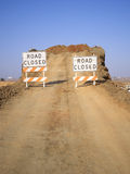 Road Closed. Unfinished dirt ramp to nowhere with construction signs that say road closed Stock Image