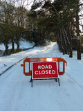 Road closed. Sign bars traffic from snow covered road Royalty Free Stock Photo