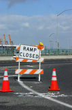 Road Closed. A road closed barrier and orange cones Stock Photography