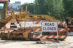 Road Closed 2. Road closed sign with earth moving equipment Stock Photos