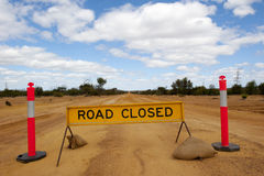 Road Closed. After heavy rain in the outback a dirt track leading into the far distance became a slippery traffic hazard and too dangerous to drive, so the road Royalty Free Stock Photo