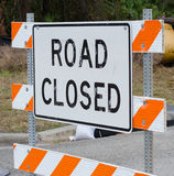 Road Closed. Sign with orange and white stripes Royalty Free Stock Photos