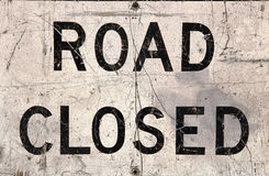 Road Closed. Beatup road closed sign stock photography