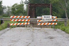 Road Closed. Sign on a rural road with a bridge out in the background Royalty Free Stock Photo