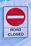 Road closed. Sign on white fence Stock Photography
