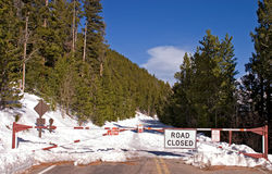 Road is closed. Road closed barrier on a snowy road Royalty Free Stock Image
