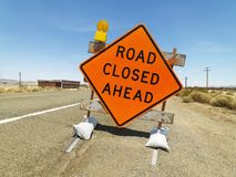Road closed ahead sign. Road sign on rural highway warning that road is closed ahead Royalty Free Stock Images