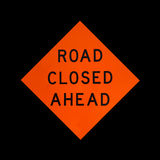 Road closed ahead sign on black background Royalty Free Stock Image