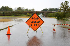 Road Closed Ahead Sign Over Rain Flooded Street Stock Photography