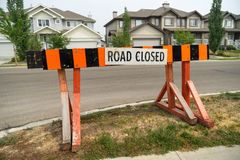 Road closed barrier on residential street curb royalty free stock images