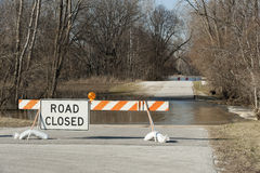 Road Closed Due To Flood. Road closed sign with flooded road and the Maumee river in the background Stock Photos