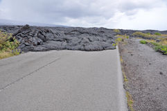 Road closed by lava in Hawaii. Volcanoes National Park Stock Photo