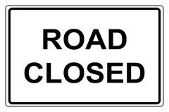 Road closed. Rectangular sign with text 'road closed' written in black uppercase letters on white , black border line Stock Images