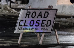 Road Closed. Rickety well used sign stating Road Close per order of the police stock photography