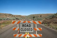 Road closed sign. Construction warning road closed sign middle of asphalt road outdoor day time Stock Images