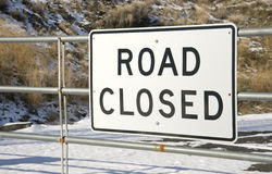 Road Closed Sign on Gate Snow Covered Winter Stock Photos