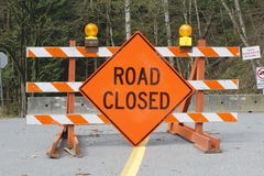 Road Closed Sign. A large orange sign warns motorists that the road is closed Royalty Free Stock Photography