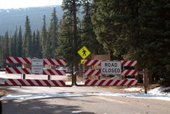 Road closed sign. A road block sign in the rocky mountains royalty free stock photo