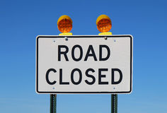 Road closed sign against a bright blue sky Stock Images