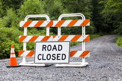 Road closed sign. A road closed sign with a barricade, America stock images