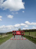 Road closed. Sign on barrier due to resurfacing work on single country lane through countryside and farmland Stock Photography