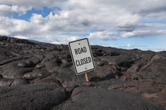 Road Closed Sign Buried in Lava Stock Photos