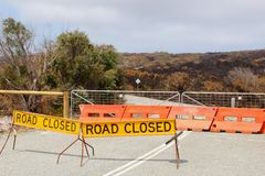 Road closed sign after the bushfires, Western Australia. Road closed sign after the bushfires in Western Australia. Bushfires are very common here and are very Stock Images