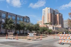 Road closed sign in Downtown Irving, Texas, USA. Under cloud blue sky. Barricade closures, cones with construction equipments and high-rise building in Royalty Free Stock Photo