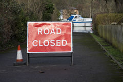 Road closed sign, flooding. Road closed due to flooding during winter UK floods 2014 Royalty Free Stock Image