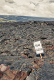 Road closed sign and highway damaged by lava Stock Photos
