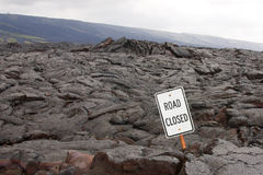 Road closed sign in the middle of a lava flow Stock Photo