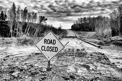 Road Closed sign posted by wood bridge Stock Image