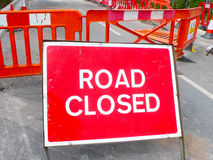 Road closed sign. Red warning road closed sign in the middle of the road UK Royalty Free Stock Photos