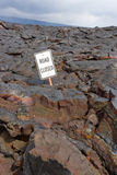 The Road Closed sign on the road buried in lava  from the erupti Royalty Free Stock Photography