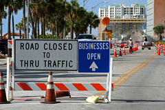 Road closed sign and road construction. Next to beach stock image