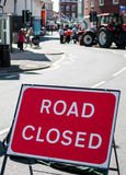 Road Closed. Sign showing road closed with tractor in background Stock Photos